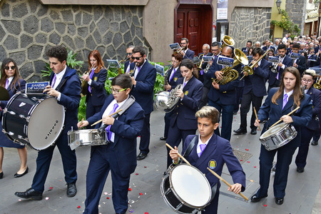 Tenerife, Canary Islands, Spain - April 01, 2018: Unidentified brass band by traditional religious Easter procession in the streets of Puerto de la Cruz