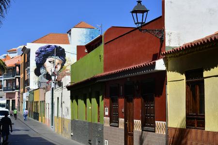 Tenerife, Canary Islands, Spain - April 03, 2018: Buildings with colorful facade and painted walls in La Ranilla district in Puerto de la Cruz Stock Photo - 115218062