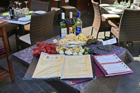 Tenerife, Canary Islands, Spain - April 03, 2018: Table in Restaurant decorated with food and menu card in La Ranilla district in Puerto de la Cruz Stock Photo - 115218077