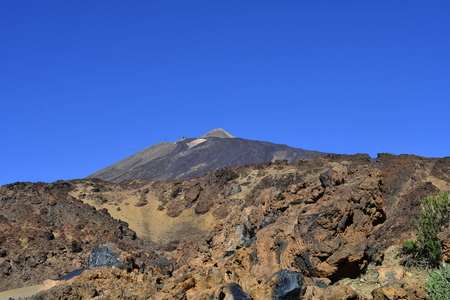 Spain, Canary Islands, Tenerife, caldera with lave rocks in Teide national park with peak of Teide