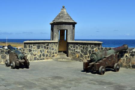 Spain, Canary Islands, Tenerife, old cannons in public Castillo San Felipe, a medieval fortress in Puerto de la Cruz Stock Photo