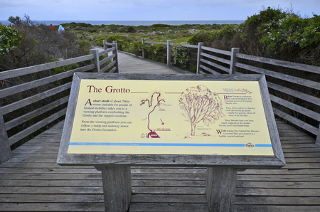 Peterborough, VIC, Australia - November 07, 2017: Board with decription on footpath to natural arch The Grotto in Port Campbell national park, part of the Great Ocean Road area Editorial