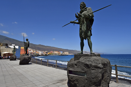 Tenerife, Canary Islands, Spain - April 06, 2018: Coast on Atlantic ocean with bronze sculptures made from sculptor Jose Abad in village Candelaria