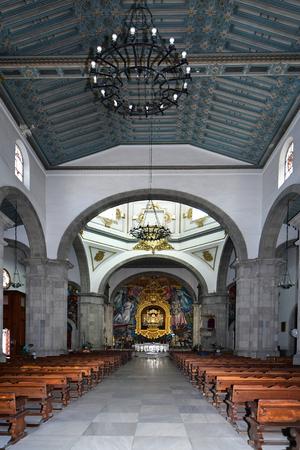 Tenerife, Canary Islands, Spain - April 06, 2018: Inside public Basilica de Nuestro Senora de Candelaria with the black madonna in village Candelaria