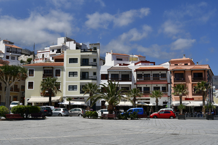 Tenerife, Canary Islands, Spain - April 06, 2018: Different buildings and restaurants on main square named Plaza de la Patrona de Canaris in village Candelaria