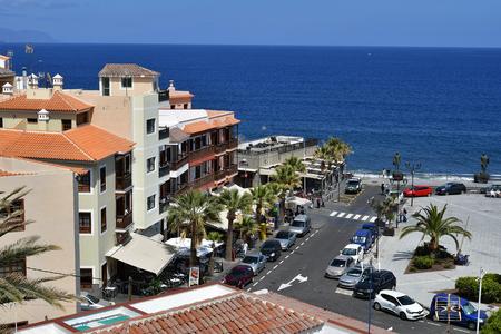 Tenerife, Canary Islands, Spain - April 06, 2018: Unidentified people and buildings on Plaza de la Patrona de Canaris with bronze sculptures in village Candelaria Editorial