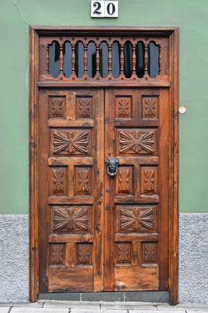 Spain, Canary Islands, Tenerife, wooden front door with door knocker in La Orotava village