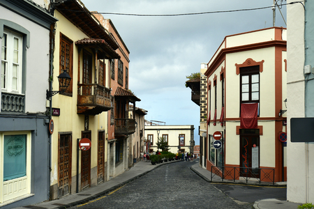 Tenerife, Canary Island, Spain - April 07, 2018: Unidentified people and buildings with wooden balconies in the mountain village La Orotava Editorial