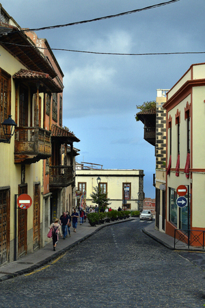 Tenerife, Canary Island, Spain - April 07, 2018: Unidentified people and buildings with balconies in the mountain village La Orotava