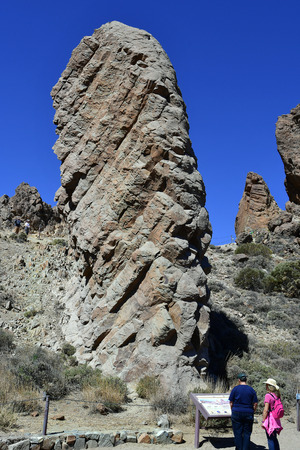 Tenerife, Canary Islands, Spain - April 05, 2018: Unidentified people at stunning rock formation  Los Roques de Garcia in Teide national park Editorial