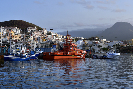 Tenerife, Canary Islands, Spain - April 10, 2018: Trawler and rescue ship in the harbor of Los Cristianos