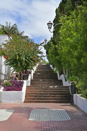 Spain, Canary Islands, Tenerife, walkway with lanterns up from city center in Puerto de la Cruz