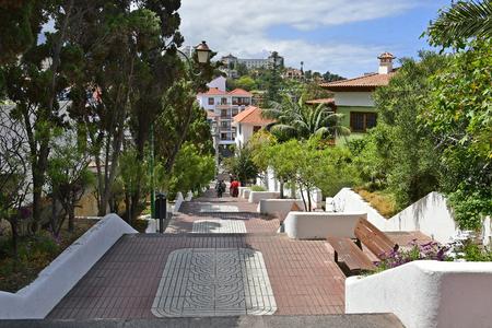 Spain, Canary Islands, Tenerife, unidentified people on walkway down to city center in Puerto de la Cruz Editorial