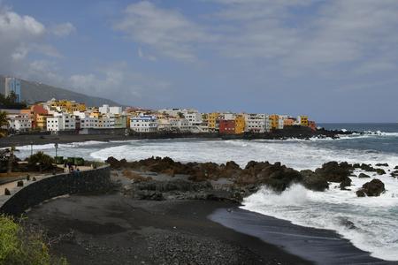 Tenerife, Canary Islands, Spain - April 09, 2018: Unidentified people on beach Playa Jardin in Puerto de la Cruz