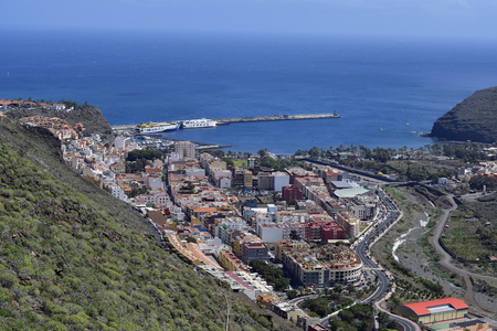 La Gomera, Canary Islands, Spain - April 10, 2018: Aerial view to capital San Sebastian with harbor and ferry ships