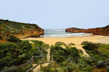 Australia, VIC, footpath to beach on Bay of Martyrs in Port Campbell national park on Great Ocean Road, preferred tourist attraction and travel destination, Stockfoto