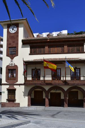 Spain, Canary Islands, La Gomera, townhall with flags in the capital San Sebastian