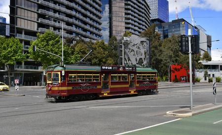 Melbourne, VIC, Australia - November 03, 2017: City Circle Tram and artwork named Continuum by Michael Snape situated on Harbour Esplanade in Docklands district