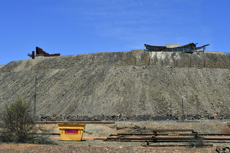 Australia, industrial site with buildings on spoil heap in the village of Broken Hill