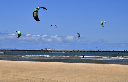 Melbourne, VIC, Australia - November 04, 2017: Unidentified kite surfer and people on St.Kilda pier, preferred recreation and water sport area in the capital of Victoria Editorial