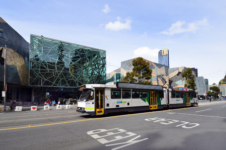 Melbourne, VIC, Australia - November 05, 2017: Unidentified people, tramway and federation square building, location for arts, culture and public events at CBD of Melbourne.