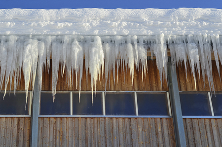 Winter, icicles on farm building