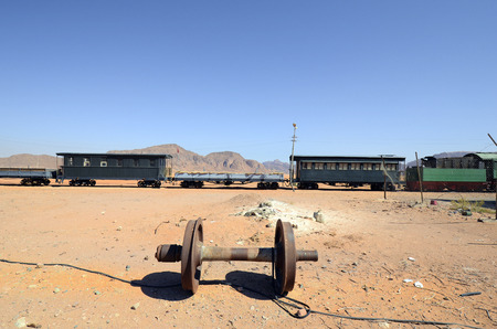 Jordan, old railway waggons and wheel in nostalgic Wadi Rum station