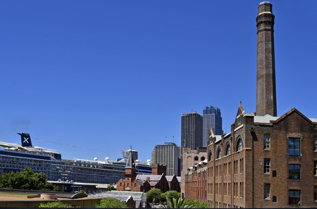 Sydney, NSW, Australia - October 30, 2017: The Rocks district with old ware house, ASNC building, terminal and cruise ship on Circular Quay