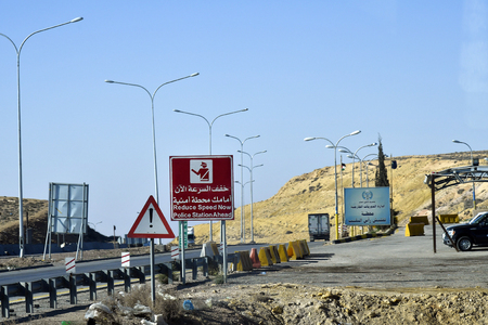 Jordan, March 06, 2019: Sign for police station on highway near Aqaba