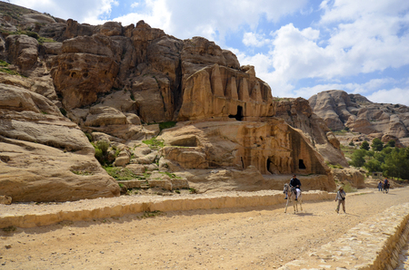 Petra, Jordan - March 06, 2019: unidentified equestrian at Bab el-Siq and Tomb of Obelisk in the Unesco World Heritage site of ancient Petra