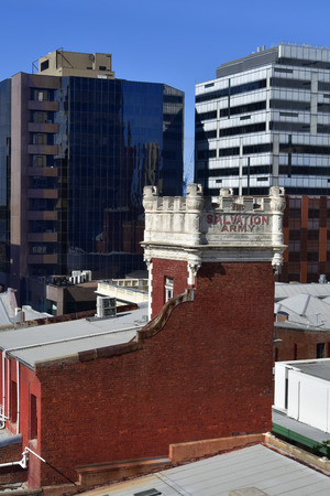 Australia, Perth, roof of Salvation Army building with new skyscrapers behind Editorial