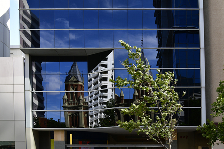 Australia, Perth, reflection of old town hall in glass facade in CBD of the Western Australia capital