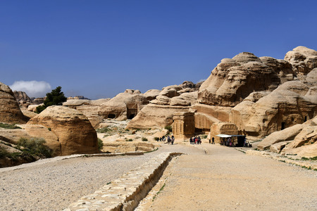 Wadi Musa, Jordan - March 06, 2019: Unidentified people on unsealed road named The Siq, way to UNESCO World Heritage site ancient Petra Editorial