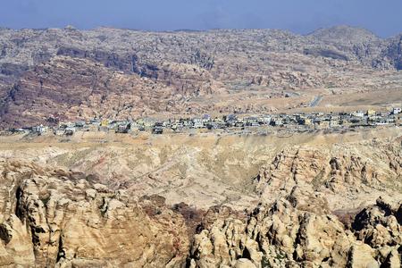 Jordan, village Wadi Musa inmidst arid landscape and mountains