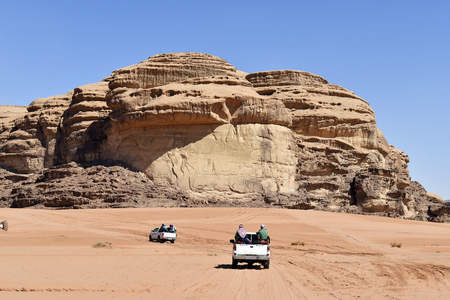 Jordan, Unidentified tourists in cars to explore the great scenery of Wadi Rum