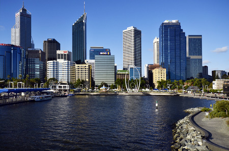 Perth, WA, Australia - November 27, 2017: Skyline from Perth on Swan river with different buildings, carrousel and Spanda sculpture on Elizabeth Quay Esplanade