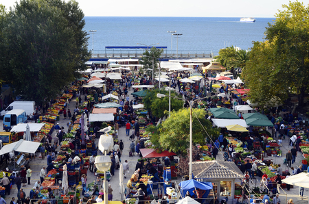 Kavala, Greece - September 22, 2012: Crowd of unidentified people and market stalls on the weekly street market for fruits and vegetables Editorial