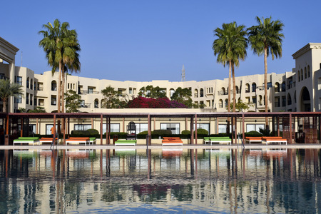 Aqaba, Jordan - March 04, 2019: Tala Bay hotel complex with pool and sun beds, situated on Red Sea