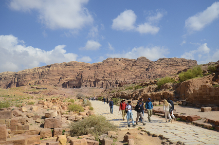 Petra, Jordan - March 06, 2019: Unidentified people at UNESCO World heritage site of ancient Petra with royal tombs in background Editorial