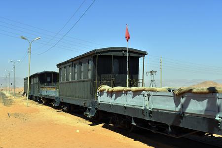Jordan, nostalgic armed railway waggon with former machine gun defence position in Wadi Rum station Editorial