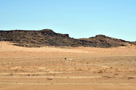 Jordan, Wadi Rum, lonesome car in desert landscape  in Middle East