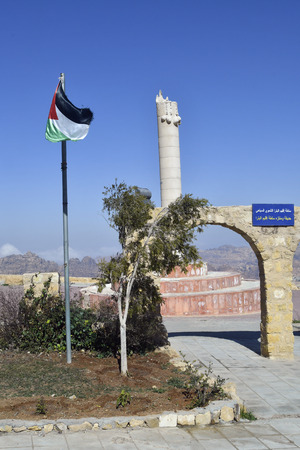 Jordan, memorial with column and flag above Wadi Musa town