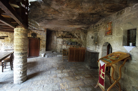 Greece, Epirus, living room in public medieval monastery Kipinas, built in 13th Century into rock face