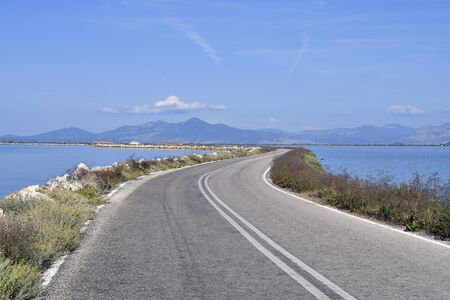 Greece, Epirus, narrow road on dam in Koronissia village situated in Ambracian Gulf aka Gulf of Arta, only connection to mainland