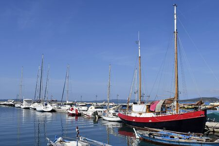 Greece, Epirus, Koronissia, saling ships and yachts in the harbor in Ambracian Gulf Stock Photo