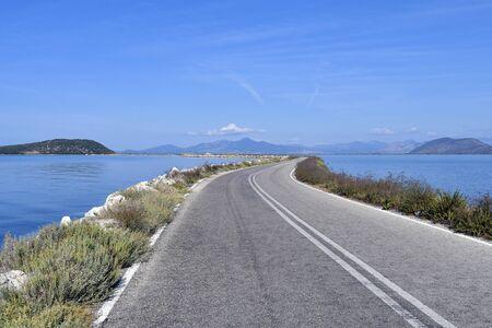 Greece, Epirus, road on narrow dam in Ambracian Gulf aka Gulf of Arta connection to mainland 版權商用圖片