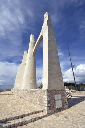 Kamarina, Greece - September 20, 2019: Monument of Zalongo, 19th century remembrance of a woman and woman's suicide, made by George Zongolopoulos, 版權商用圖片 - 134991332