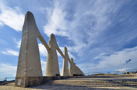Kamarina, Greece - September 20, 2019: Monument of Zalongo, 19th century remembrance of a woman and woman's suicide, made by George Zongolopoulos, 版權商用圖片 - 134991333
