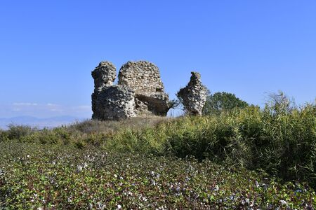 Greece, ancient amphipolis, part of fortified wall and field with cotton