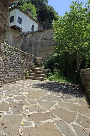 Greece, Epirus, entrance and murial at monastery of the Panagia Spileotissa aka Monastery of the Dormition of the Virgin in Vikos-Aoos national park 版權商用圖片